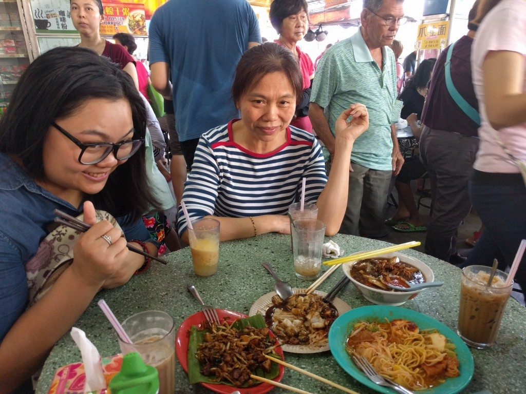 The first round of food for breakfast at Jelutong Morning Market... all eyes on Freya.