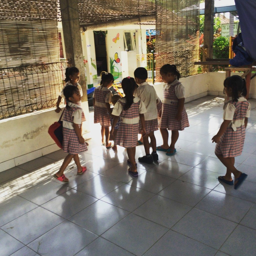 This is Freya getting lost amongst the kids that want to play with her at the local kindergarten. We take Freya there at 10:00am when the kids get out of school.