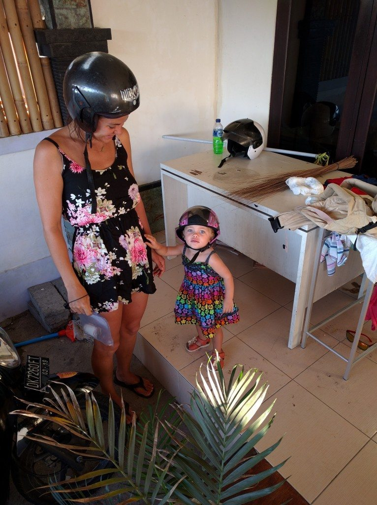 Freya is all set to go with her helmet on. Just waiting on me to take the picture, then we're off on another moped ride.