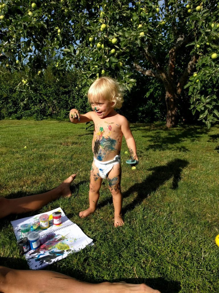 Freya painting in the back yard.